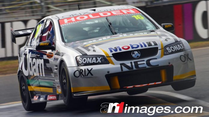 Paul Dumbrell races his Holden V8 Supercar through the Senna Chicane, 2008 Clipsal 500 Adelaide.